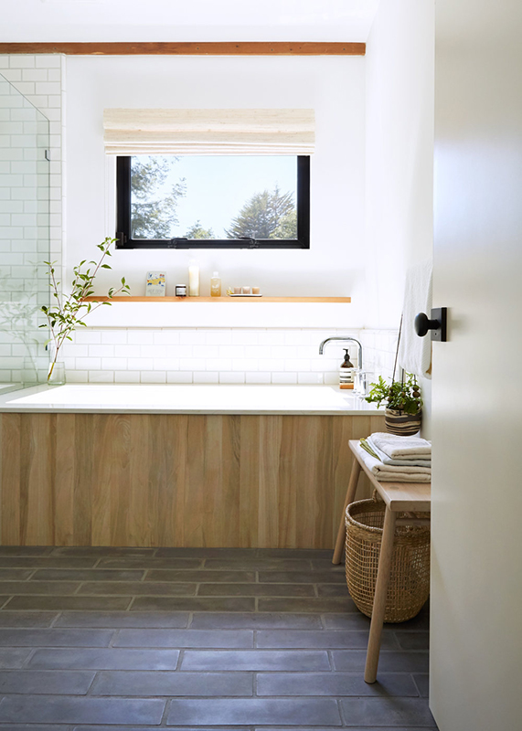 A beautiful home bathroom with a large window.