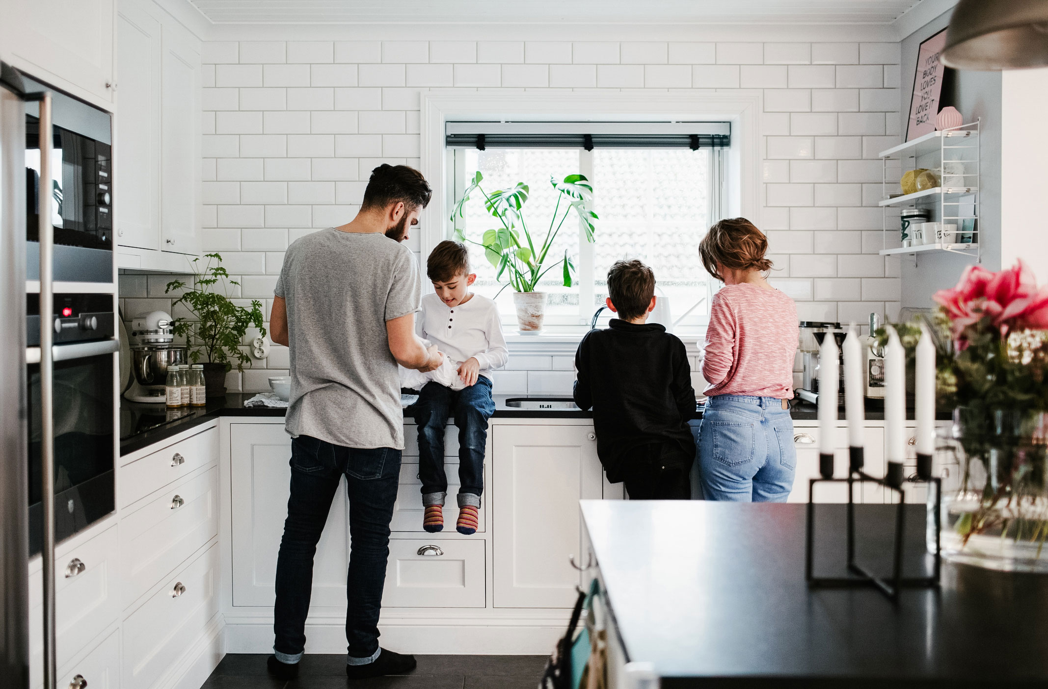 A young family in a modern kitchen.