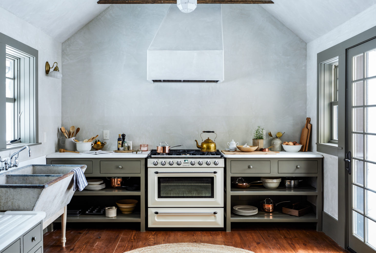 A lovely kitchen with a sloped ceiling.